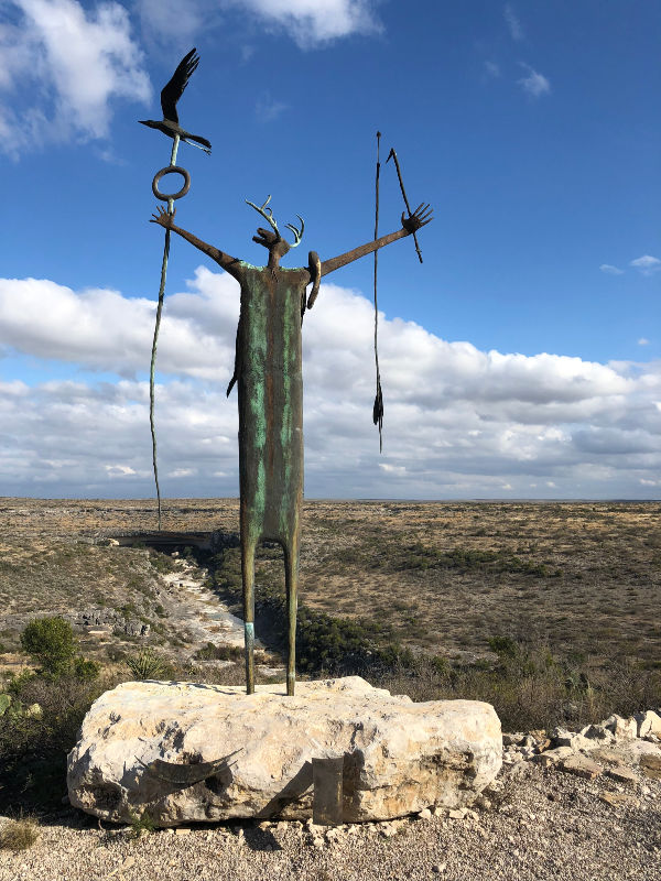 Maker of Peace statue created by Bill Worrell as a tribute to the Desert Archaic people whose pictographs adorn the canyon walls.